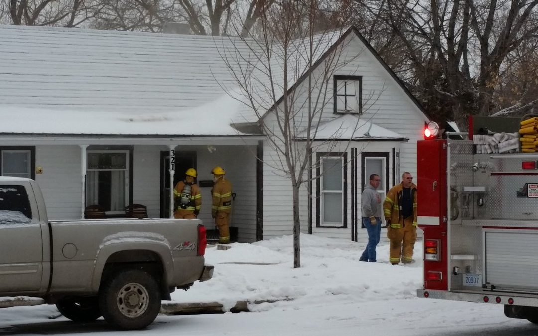 Emergency Personnel Responds to House Fire
